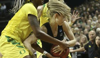 Oregon's Ruthy Hebard, left, and Sabrina Ionescu, behind, pressure Portland State's Sidney Rielly, right, during the first half of of a first-round game of the NCAA women's college basketball tournament Friday, March 22, 2019, in Eugene, Ore. (AP Photo/Chris Pietsch)