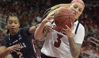 Louisville forward Sam Fuehring (3) battles Robert Morris guard Nia Adams (2) for a rebound during the first half of a first-round game in the NCAA women's college basketball tournament in Louisville, Ky., Friday, March 22, 2019. (AP Photo/Timothy D. Easley)
