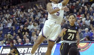 Connecticut's Crystal Dangerfield (5) goes up for two points against Towson's Qierra Murray (11) during a first round women's college basketball game in the NCAA Tournament, Friday, March 22, 2019, in Storrs, Conn. (AP Photo/Stephen Dunn)
