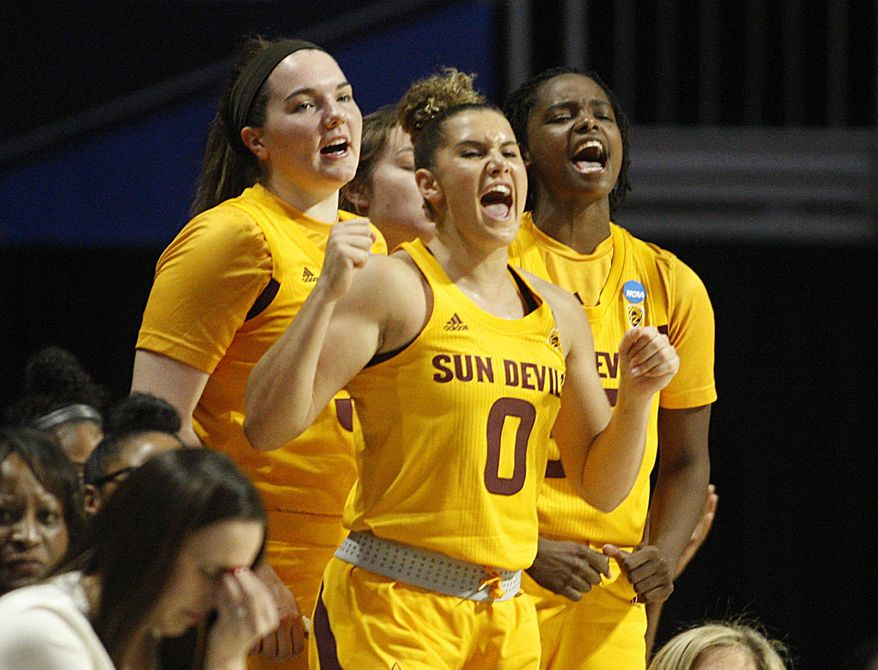 Arizona State guard Taya Hanson (0) leads the bench in cheering for her team, during a first round women's college basketball game against UCF, in the NCAA Tournament in Friday, March 22, 2019, in Coral Gables, Fla. (AP Photo/Luis M. Alvarez)