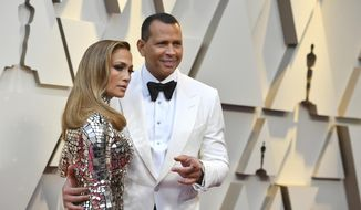 FILe - In this Feb. 24, 2019 file photo, Jennifer Lopez, left, and Alex Rodriguez arrive at the Oscars  at the Dolby Theatre in Los Angeles.  Barack Obama is feeling the love about the engagement of Lopez and Rodriguez. A-Rod on Thursday, March 22, 2019 on Twitter shared a handwritten note that he received in which the former president and his wife, Michelle, congratulated the couple. (Photo by Jordan Strauss/Invision/AP, File)