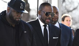 R. Kelly, right, arrives at the Leighton Criminal Court for a hearing on Friday, March 22, 2019, in Chicago. (AP Photo/Matt Marton)