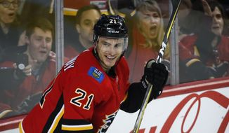 Calgary Flames' Garnet Hathaway celebrates his goal during first-period NHL hockey game action against the Ottawa Senators in Calgary, Alberta, Thursday, March 21, 2019. (Jeff McIntosh/The Canadian Press via AP) ** FILE **
