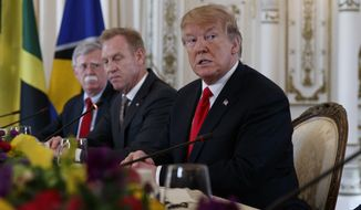 From left, National Security Adviser John Bolton, Acting Defense Secretary Patrick Shanahan and President Donald Trump sit together during a meeting with Caribbean leaders at Mar-A Lago, Friday, March 22, 2019, in Palm Beach, Fla. (AP Photo/Carolyn Kaster) ** FILE **