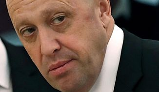FILE - In this July 4, 2017 file photo, Russian businessman Yevgeny Prigozhin is shown prior to a meeting of Russian President Vladimir Putin and Chinese President Xi Jinping in the Kremlin in Moscow, Russia. (Sergei Ilnitsky/Pool Photo via AP, File)