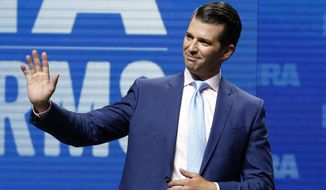 FILE - In this May 4, 2018, file photo, Donald Trump Jr., waves from the stage at the National Rifle Association in Dallas. (AP Photo/Sue Ogrocki, File)
