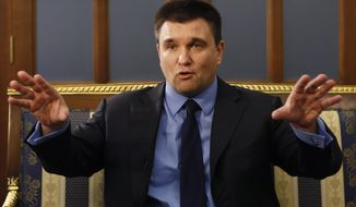 Ukrainian Minister for Foreign Affairs Pavlo Klimkin talks during an interview with The Associated Press in Kiev, Ukraine, Friday, March 22, 2019. With President Petro Poroshenko slipping in the polls a week ahead of elections, Ukraine's government is trying to put a brave face on his achievements, insisting it is well on its way to delivering on the demands of the Maidan protest movement that drove the previous Russian-backed president from power in 2014. (AP Photo/Efrem Lukatsky)