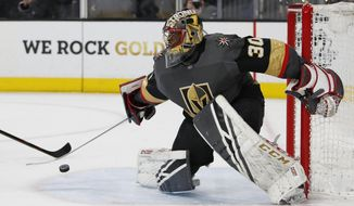 Vegas Golden Knights goaltender Malcolm Subban blocks shot by the Winnipeg Jets during the first period of an NHL hockey game Thursday, March 21, 2019, in Las Vegas. (AP Photo/John Locher)