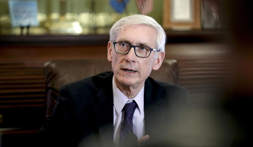 Wisconsin Gov. Tony Evers answered reporters questions at the State Capitol in Madison, Wisc.,  Thursday, March 21, 2019, after a Dane County judge has blocked the lame duck laws that Republicans passed in December to limit the power of the governor and attorney general. (Steve Apps/Wisconsin State Journal via AP)