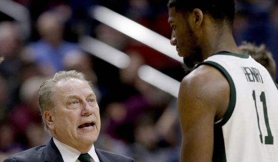Michigan State coach Tom Izzo talks to Aaron Henry (11) during the second half of a second round men's college basketball game against Minnesota in the NCAA Tournament, in Des Moines, Iowa, Saturday, March 23, 2019. (AP Photo/Nati Harnik)