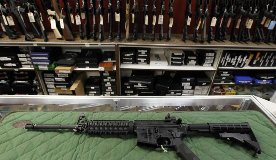 In this Thursday, July 26, 2012 file photo, an AR-15 style rifle is displayed at the Firing-Line indoor range and gun shop, in Aurora, Colo. (AP Photo/Alex Brandon, File)