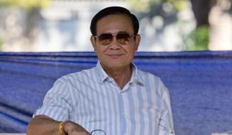 Thai Prime Minister Prayuth Chan-ocha cast his ballot in Bangkok on Sunday during the nation's first general election since the military seized power in a 2014 coup. (Associated Press)