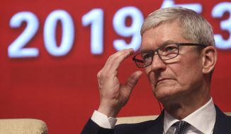 "Apple CEO Tim Cook reacts during the Economic Summit held for the China Development Forum in Beijing, China, Saturday, March 23, 2019. Cook says he's ""extremely bullish"" about the global economy based on the amount of innovation being carried out, and he's urging China to continue to ""open up."" (AP Photo/Ng Han Guan)"