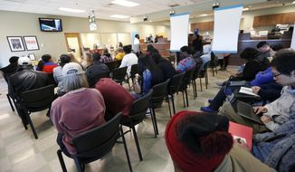 People fill the Pearl, Miss., driver license station, Wednesday, March 20, 2019. Getting a new driver's license in Mississippi can be a multiday ordeal with long lines at short-staffed license stations. Some people are driving long distances to seek shorter lines in smaller towns.  (AP Photo/Rogelio V. Solis)