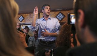Former Texas congressman Beto O'Rourke addresses a gathering during a campaign stop at a restaurant in Manchester, N.H., Thursday, March 21, 2019. O'Rourke announced last week that he'll seek the 2020 Democratic presidential nomination. (AP Photo/Charles Krupa)