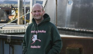 """In this photo taken March 14, 2019, Tom Minio, the elder statesman of Kodiak's scallop fishery, poses in Kodiak, Alaska. With regards to scallops, Tom Minio could accurately be described as erudite. On a recent afternoon, Minio sat in the galley of his vessel, the Provider, explaining what makes the best product, while the metallic screeches of boat work drifted in from other parts of the vessel. """"The market really loves the big stuff, which I don't understand. I don't like eating big scallops,"""" he said. """"It's just like old halibut, you know: the bigger they are, the older they are and the tougher they are."""" (Alistair Gardiner/Kodiak Daily Mirror via AP)"""