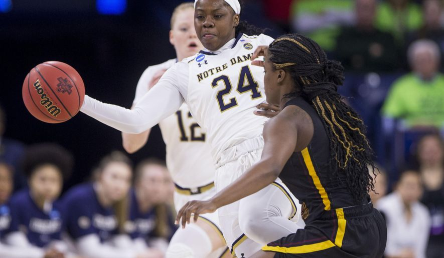 Notre Dame's Arike Ogunbowale (24) passes the ball around Bethune-Cookman's Armani Walker (5) during a first round women's college basketball game in the NCAA Tournament in South Bend, Ind., Saturday, March 23, 2019. (AP Photo/Robert Franklin)