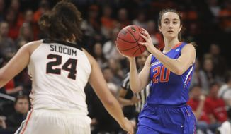 Boise State's Marta Hermida (20) looks for a way past Oregon State's Destiny Slocum (24) during the first half of a first-round game of the NCAA women's college basketball tournament in Corvallis, Ore., Saturday, March 23, 2019. (AP Photo/Amanda Loman)