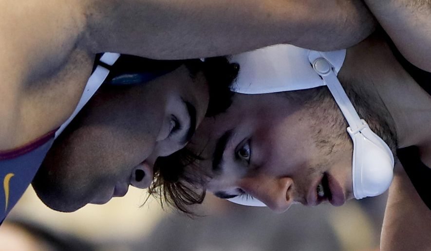 Penn State's Anthony Cassar, right, and Minnesota's Gable Steveson tangle during their 285 pound match in the semifinals of the NCAA wrestling championships, Friday, March 22, 2019, in Pittsburgh. Cassar won and will face Oklahoma State's Derek White in the finals Saturday. (AP Photo/Keith Srakocic)