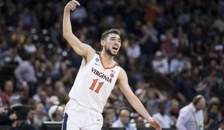 Virginia guard Ty Jerome (11) celebrates a score against Gardner-Webb during a first-round game in the NCAA men's college basketball tournament Friday, March 22, 2019, in Columbia, S.C. Virginia defeated Gardner-Webb 71-56. (AP Photo/Sean Rayford)