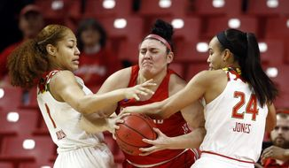 Maryland forwards Shakira Austin, left, and Stephanie Jones, right, pressure Radford center Sydney Nunley as Nunley tries to keep possession of the ball in the first half of a first round women's college basketball game in the NCAA Tournament, Saturday, March 23, 2019, in College Park, Md. (AP Photo/Patrick Semansky)