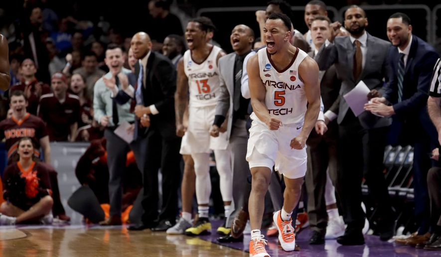 Virginia Tech guard Justin Robinson celebrates during the first half of the team's first-round game against Saint Louis in the NCAA men's college basketball tournament Friday, March 22, 2019, in San Jose, Calif. (AP Photo/Jeff Chiu)