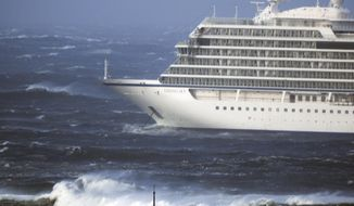 The cruise ship Viking Sky lays at anchor in heavy seas, after it sent out a Mayday signal because of engine failure in windy conditions, near Hustadvika, off the west coast of Norway, Saturday March 23, 2019.  The Viking Sky is forced to evacuate its 1,300 passengers. (Frank Einar Vatne / NTB scanpix via AP)