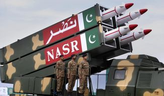 A Pakistani-made ballistic missile NASR is loaded on a trailer rolls down during a military parade to mark Pakistan National Day, in Islamabad, Pakistan, Saturday, March 23, 2019. Pakistanis are celebrating their National Day with a military parade that's showcasing short- and long-range missiles, tanks, jets, drones and other hardware. (AP Photo/Anjum Naveed)
