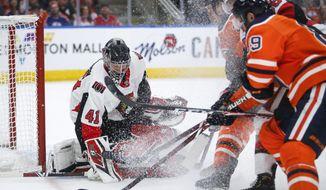 Ottawa Senators goaltender Craig Anderson (41) makes a save against Edmonton Oilers' Sam Gagner (89) during second-period NHL hockey game action in Edmonton, Alberta, Saturday, March 23, 2019. (Jeff McIntosh/The Canadian Press via AP)
