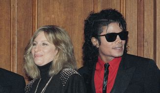 "In this Dec. 14, 1986, file photo, singers Barbra Streisand and Michael Jackson attend the Scopus Awards of the American Friends of the Hebrew University ceremony in Los Angeles. Streisand is apologizing outright for her comments about sexual abuse allegations against Michael Jackson. She said in a second statement Saturday, March 23, 2019, that she should have chosen her words more carefully, and admires the accusers for ""speaking their truth."" (AP Photo/Mark Avery, File)"