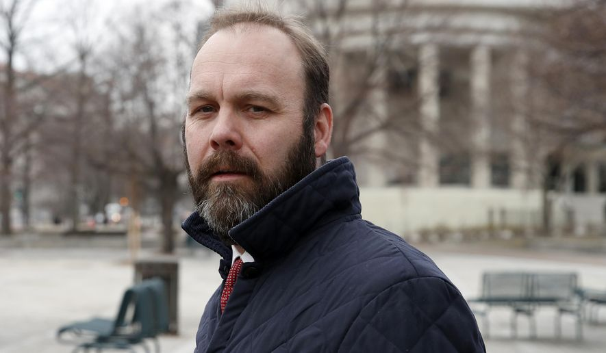 FILE - in this Feb. 14, 2018, file photo, Rick Gates departs Federal District Court in Washington.  (AP Photo/Alex Brandon, File)