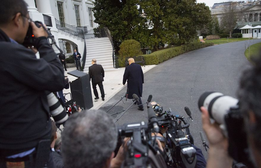 "President Donald Trump, center, walks away after speaking to the media following his arrival on Marine One helicopter on the South Lawn of the White House, Sunday, March 24, 2019, in Washington. The Justice Department said Sunday that special counsel Robert Mueller's investigation did not find evidence that President Donald Trump's campaign ""conspired or coordinated"" with Russia to influence the 2016 presidential election. (AP Photo/Pablo Martinez Monsivais)"