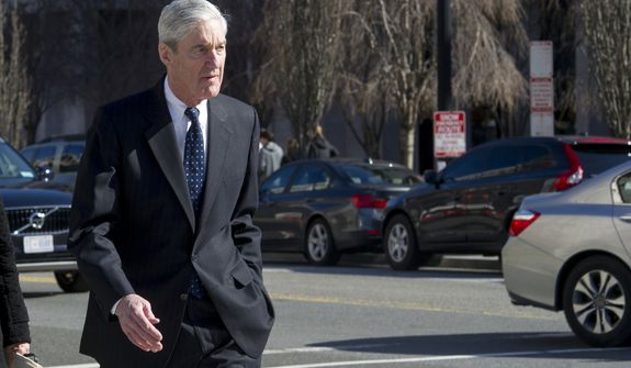 Special Counsel Robert Mueller walks to his car after attending services at St. John's Episcopal Church, across from the White House, in Washington, Sunday, March 24, 2019. Mueller closed his long and contentious Russia investigation with no new charges, ending the probe that has cast a dark shadow over Donald Trump's presidency. (AP Photo/Cliff Owen)