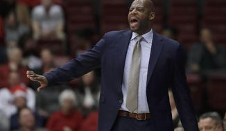 FILE - In this March 7, 2019, file photo, California coach Wyking Jones gestures during the first half of his team's NCAA college basketball game against Stanford in Stanford, Calif. California fired Jones after winning just eight games in each of his first two seasons. (AP Photo/Jeff Chiu, File)