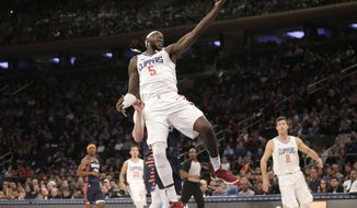 Los Angeles Clippers forward Montrezl Harrell (5) grabs a high pass during the first half of an NBA basketball game against the New York Knicks, Sunday, March 24, 2019, in New York. (AP Photo/Seth Wenig)