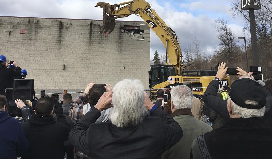 FILE - In this March 5, 2018 file photo, people take pictures during a ceremony in East Windsor, Conn., marking the start of demolition of a movie theater at the site of what they hope will be a new casino that the Mashantucket Pequot and the Mohegan tribes would operate jointly. Construction has not yet started a year later. The U.S. Department of Interior may have finally given the go-ahead to the planned satellite casino at the site, but that doesn't mean the debate over gambling in Connecticut is settled. (AP Photo/Susan Haigh, File)