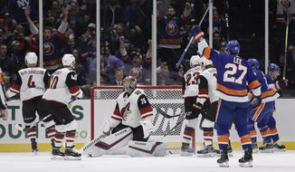 Arizona Coyotes goaltender Darcy Kuemper (35) reacts after New York Islanders' Jordan Eberle scored a goal during the first period of an NHL hockey game Sunday, March 24, 2019, in Uniondale, N.Y. (AP Photo/Frank Franklin II)
