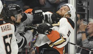 Los Angeles Kings center Adrian Kempe, left scuffles with Anaheim Ducks defenseman Korbinian Holzer during the second period of an NHL hockey game Saturday, March 23, 2019, in Los Angeles. (AP Photo/Mark J. Terrill)
