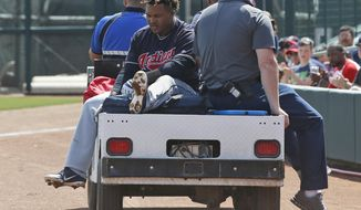 Cleveland Indians' Jose Ramirez is taken off the field on a cart after an injury during the third inning of the team's spring training baseball game against the Chicago White Sox on Sunday, March 24, 2019, in Glendale, Ariz. (AP Photo/Sue Ogrocki)