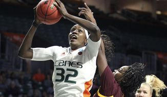 Miami's Beatrice Mompremier pulls in a rebound as Arizona State's Charnea Johnson-Chapman (33) defends during a second-round women's college basketball game in the NCAA Tournament, Sunday, March 24, 2019, in Coral Gables, Fla. (AP Photo/Luis M. Alvarez)