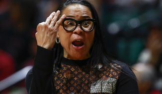 South Carolina head coach Dawn Staley talks to her team while facing Florida State during the first half of a second-round women's college basketball game in the NCAA Tournament in Charlotte, N.C., Sunday, March 24, 2019. (AP Photo/Jason E. Miczek)