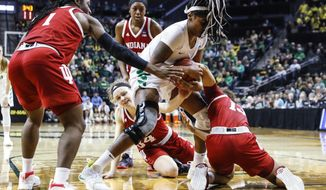 Oregon forward Ruthy Hebard (24), fights for a loose ball against Indiana guard Jaelynn Penn (13), during a second-round game of the NCAA women's college basketball tournament Sunday, March 24, 2019, in Eugene, Ore. (AP Photo/Thomas Boyd)