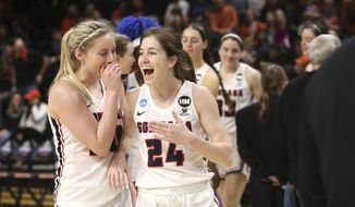 Gonzaga's Katie Campbell (24) and Chandler Smith (30) celebrate their win over Little Rock following a first-round game of the NCAA women's college basketball tournament in Corvallis, Ore., Saturday, March 23, 2019. (AP Photo/Amanda Loman)