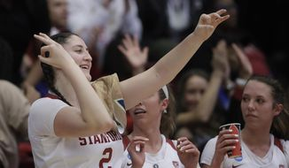 Stanford's Shannon Coffee gestures after a teammate scored during a first-round game against UC Davis in the NCAA women's college basketball tournament in Stanford, Calif., Saturday, March 23, 2019. On Monday night, Coffee will sign the national anthem before Stanford's scheduled second-round game at Maples Pavilion. (AP Photo/Jeff Chiu)