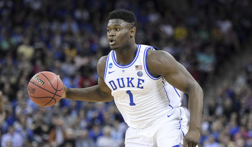 Duke forward Zion Williamson (1) dribbles the ball against Central Florida during the first half of a second-round game in the NCAA men's college basketball tournament Sunday, March 24, 2019, in Columbia, S.C. (AP Photo/Sean Rayford)