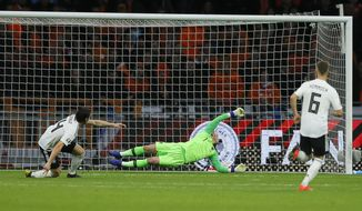 Germany's Nico Schulz scores his side's third goal during the Euro 2020 group C qualifying soccer match between Netherlands and Germany at the Johan Cruyff ArenA in Amsterdam, Sunday, March 24, 2019. (AP Photo/Peter Dejong)