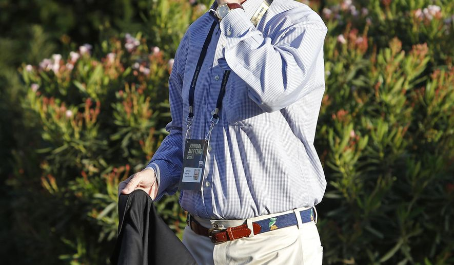 New York Giants co-owner and President John K. Mara talks on his phone as he walks to a meeting during the annual NFL owners meetings, Sunday, March 24, 2019, in Phoenix. (AP Photo/Ralph Freso)