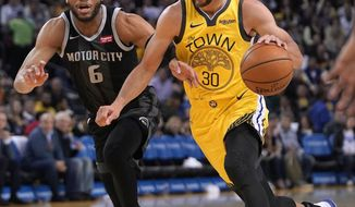 Golden State Warriors guard Stephen Curry (30) dribbles past Detroit Pistons guard Bruce Brown (6) during the second half of an NBA basketball game Sunday, March 24, 2019, in Oakland, Calif. (AP Photo/Tony Avelar)