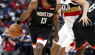 Houston Rockets guard James Harden (13) drives past New Orleans Pelicans guard Kenrich Williams (34) during the first half of an NBA basketball game in New Orleans, Sunday, March 24, 2019. (AP Photo/Tyler Kaufman)