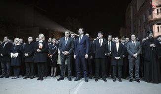 In this photo provided by the Serbian government, Serbian President Aleksandar Vucic, centre, along with other dignitaries, attend a remembrance ceremony to mark the twentieth anniversary of the 1999 NATO intervention, in Nis, Serbia, Sunday, March 24, 2019.  Twenty years after NATO intervened to stop Serbia's onslaught in Kosovo, Belgrade on Sunday commemorated the victims of what it says was an aggression while Kosovo hailed the beginning of its national liberation. (Serbian Government via AP)